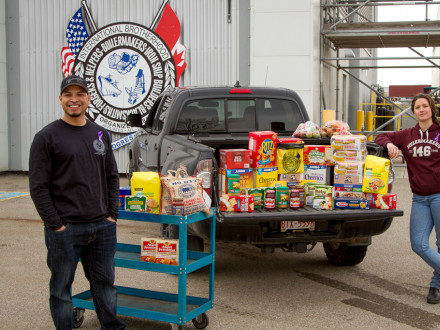 Boilermakers Calgary Rep Steve Warren and Pre-Apprentice Instructor Kayla Vander Molen collect non-perishable donations at the L-146 Calgary hall for a local Calgary food bank.