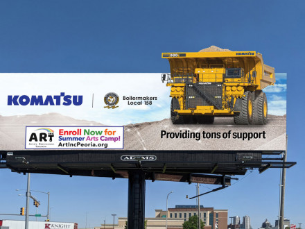 Komatsu gives a nod to Local 158, including the Boilermaker seal in its latest billboard honoring local Peoria, Illinois, charity ART, Inc. Komatsu recognizes different community nonprofits through billboards it takes out as part of the company's Tons of Support program.