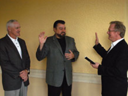 Intl. Pres. Newton. B. Jones (r.) swears in Tom Baca as the new International vi