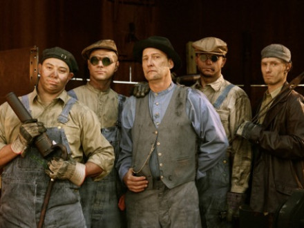 Boilermakers pose during re-enactment of a riveting scene for a new film. L. to r., Jack Dufur, Local 101; Nick Demaria, Local 83; John Standish, lead instructor with the Boilermakers National Apprenticeship Program; Joseph Fross, Local 101; and Brent Hendrix, Local 101. All but Standish are fourth-year apprentices.