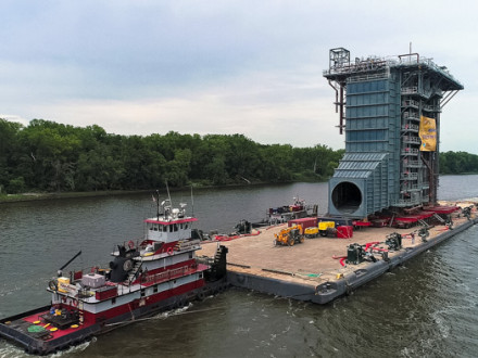 Towed, pushed and guided by three tugs, the 4,000-ton HRSG heads down the Hudson River August 7.  Photo courtesy of Drone Pilots Leon Taufield & James Griggs Sr.