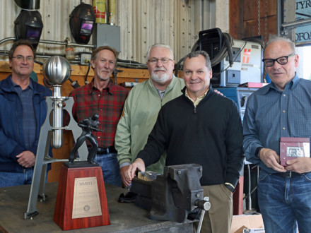 Boilermakers present Ian MacGregor, far right, with an honorary membership and a replica of Hero's steam engine. L. to r.: Dean Milton, L-146 BM-ST; Charles Jones, D-BHPD; Joe Maloney, IVP-Canada; Warren Fairley, IVP-SE; and MacGregor.