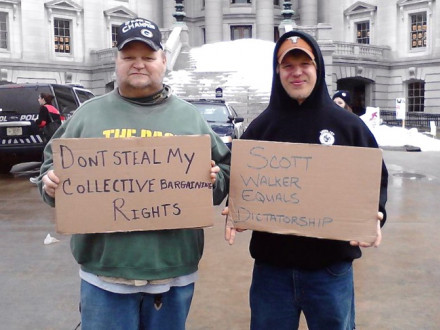 Local 107 (Milwaukee) members Jerry Maciejewski, the lodge's vice president, and Josh Brockman take part in massive union protests at the Wisconsin state capitol.