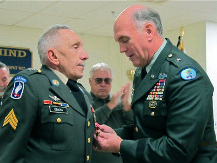 BG (RET.) TERRY WILEY pins a Bronze Star on retired L-13 member Lou DeSeta