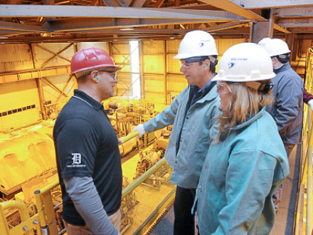 Wertz, left, talks with Reps. Kosowski and Roberts on a gallery overlooking the plant's Unit 2 turbine and generator.