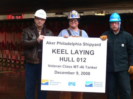 Holding a plaque for a tanker's keel-laying ceremony are, l. to r., OSG Rep Panos Hatzikyriakosm, L-19 Sec.-Treas. Fred Chamberlain, and maintenance supervisor William Bowman.