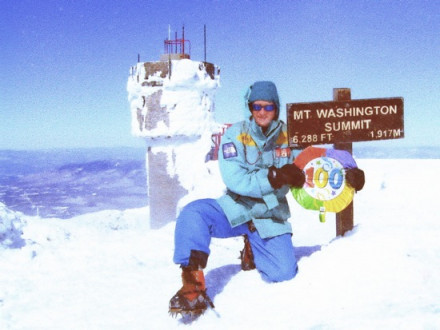 Peter Arsenault celebrates his 100th climb to the summit of Mount Washington.