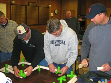 "Local 29 members (l. to r.) Brian Cahill, Chris Haynes, Kevin Sharland, and Scott Burke participate in a ""tubeworks"" exercise as part of a Jan. 14-15 field leadership class."