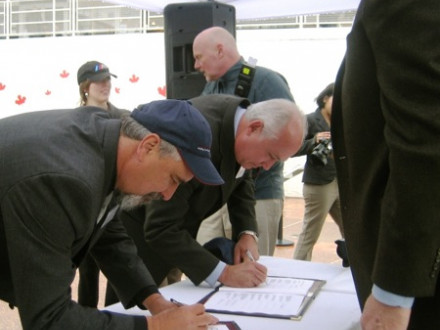 L-359 BM-ST Phil Halley, left, joins 15 other Canadian labor unions in signing a project labor agreement to modernize the Rio Tinto Alcan aluminum plant in Kitimat, British Columbia.