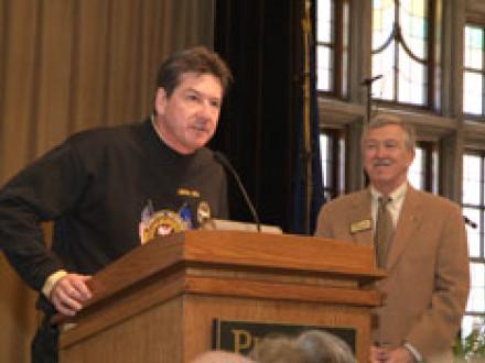 Local 374 BM-ST Paul Maday (at podium) presents an honorary union membership to retiring Purdue University President Dr. Martin C. Jischke.