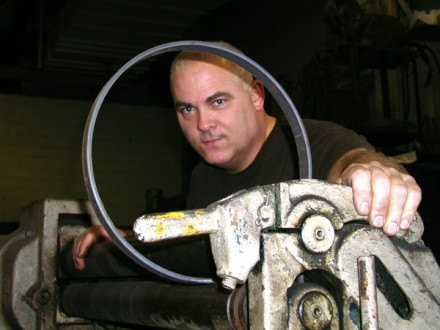 Local 5's Ray Maiara works the roller at the Central Repair Shop, where he makes parts for New York Sanitation Department vehicles.