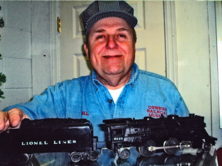 Bill Nickolas displays the locomotive and coal car from his 1950 Scout Lionel train set.