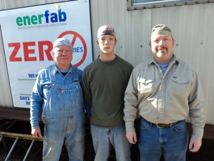 Three generations of the Goddards stand together while on an Enerfab job at AEP'