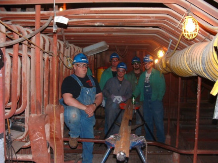 Local 85 members (l. to r.) Rick Babcock, Andy Brossia, Justin Betzer, and apprentices Jesse Green and Mike Schmitzer at DTE Energy's Monroe, Mich., plant outage in March. They are prepping roof tubes for welding.  All photos courtesy of Dennis Barker.