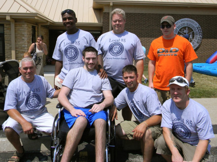 Dustin O'Shea enjoys support during a benefit July 9. First row, l. to r., appre