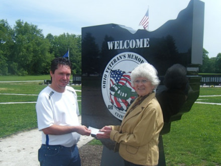 L-900 President Don Hamric stands with Chell Rossi, vice president of the Ohio Vietnam Veterans Memorial Park, in front of the marble welcome sign purchased with funds from the local and a donation from the International.