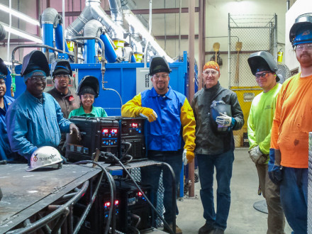 Members of L-92 train on the Miller PipeWorx 350 FieldPro. Front row, l. to r., Antonio Cardoso; Michael Ndipagbor; Leausa Finau; Karla Baeza; Oscar Davila, L-92 president and training instructor; Edwin Bogner, Miller Electric; Joe Acorn; and Tyler Rosenbaum.