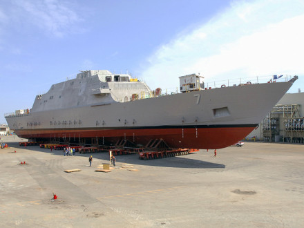 LCS 7 is rolled out of the assembly building for additional work prior to launch.