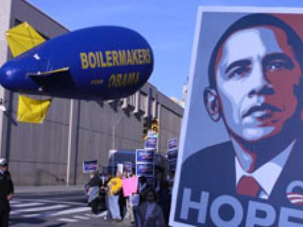 Retired IR Cam Juncal raises the Boilermaker blimp on a busy street corner before the Obama-Clinton debate April 17.