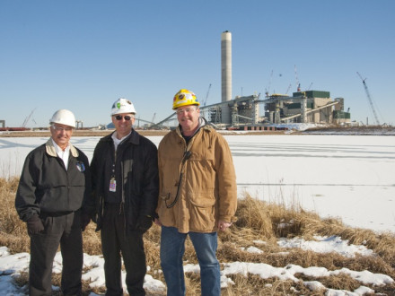 Standing in front of the massive new Prairie State Energy Campus power plant are, l. to r., Rick Eller, L-363 BM-ST; Mike Rother, PSGC director of contracts and industrial relations; and John Hoerner, L-363 member and Boilermaker general foreman.