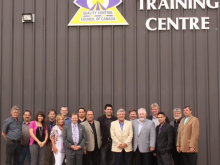 Staff and officers of the Quality Control Council of Canada stand in front of their new training centre for NDT workers in Edmonton, Alberta.