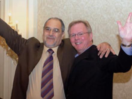 Brazilian labor leader Ricardo Baldino, l., shares a moment of international brotherhood with IP Newton Jones