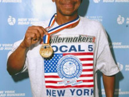 L-5 journeyman Francisco Viafara, a native of Venezuela, shows off his medal after completing the ING New York City Marathon last November.