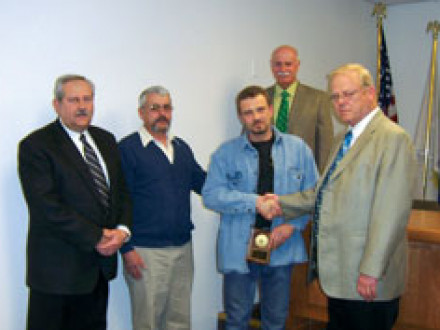 Local 1 BM-ST John J. Skermont presents the first annual Joshua A. Terando Local 1 Apprentice of the Year Award to Steven Kotyuk. L. to r.: Robert Schwartz, vice president; Jerry Terando, L-60 retiree and Joshua's dad; Kotyuk; John J. Benz, president; and Skermont.