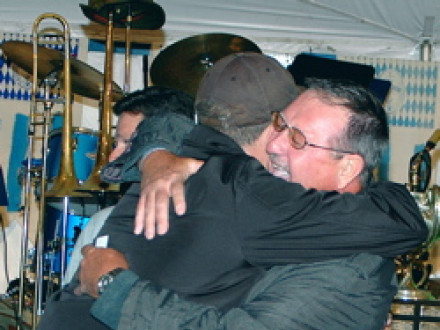 Retired AIP Bill Carey gets a big hug from son Scott upon winning a new Grady-White fishing boat.