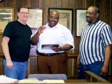 J. Frank Stephens, center, shown here receiving his 25-year pin from L-57 President Wayne Jones, l., and L-57 Sec.-Treas. William Pontious, retires after 27 years in the Brotherhood.