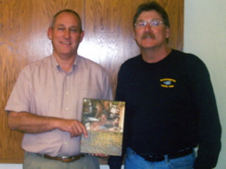 L-1620 Pres Bill Coleman (r.) presents the Boilermakers' history book to Portland Forge President Pat Bennett.