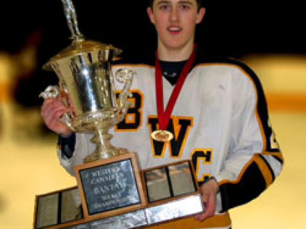 """Alex """"Bear"""" Theriau, son of L-359's Jeff Theriau, holds the winning trophy for the Western Canadian Bantam Hockey Championship. At just 15 years of age, he has been drafted to play in the Western Hockey League."""