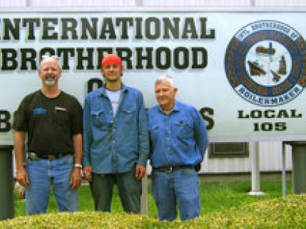 Nineteen-year-old Joshua Hutchinson, center, stands with L-105 instructors Richard Holland, left, and Bruce Stevens.