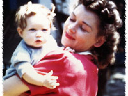 In 1943, Marjorie Jean (Seineke) Thorsen holds her infant daughter, Susan, before going to work at a shipyard during WW II.