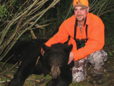 L-154's Todd Crawford with the 300-pound bear he hunted on Escape to the Wild.