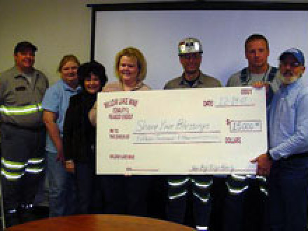Local S8 and the Big Ridge Co. donate $15,000 to the Share Your Blessings Program: l. to r., Rickie Phillips, Marzel Scates, Nicki Bishop, Katie Gulick, and Terry Ward of Big Ridge, and L-S8 Pres. Greg Fort and steward Tony Young.