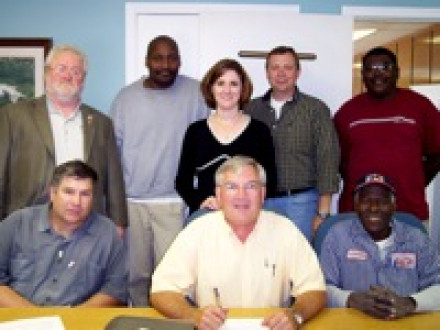 Negotiating a three-year agreement for Local D523 members at Imerys are (l. to r.), front row, D523 Pres. Gary Haynes, Kaolin Mgr. Gary Haynes, and D523 ST Raymond Foster; standing, IR John Chapman, D523's Bobby Cooper, Sr. HR Mgr. Tracee Sanders, plant mgr. Don Belcher, and production mgr. Steve Grant.