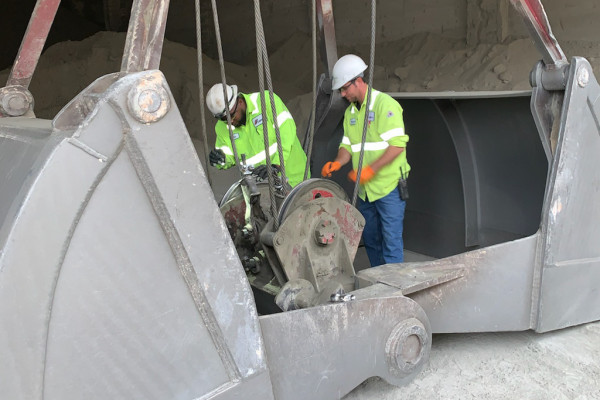 L-D23's Terris Deans, left, and Daniel Jones repair crane cables at the Cemex plant in Clinchfield, Georgia. Both Deans and Jones are in college through the plant's college education program.