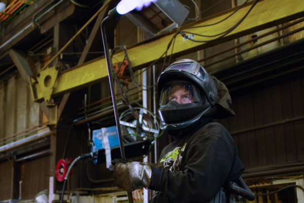 Mark Felger, L-104, fires up a rosebud torch to make the 'Cadillac of winches' at Markey Machinery in Seattle.