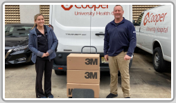 John Lacovara, L-28, delivers three cases of N-95 masks to Cooper Hospital in Camden, New Jersey, where his daughter Lauren Lacovara (pictured) works.