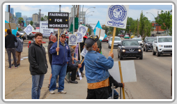 Local 146 Boilermakers are joined by their families and members of the community on the picket line in front of CESSCO. Vehicles honk on the busy road to show their support for the locked-out workers.