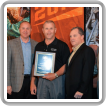 DISTRICT LODGE BM-ES CLAY HERFORD, center, accepts the top NACBE safety award on behalf of Local 587 (Orange, Texas). Joining in the presentation are (l. to r.) NACBE Exec. Dir. John Erickson, outgoing NACBE Pres. Greg Purdon, IVP-SE Warren Fairley and IP Newton Jones.