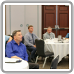 Canadian business managers listen as presenters at a training in Toronto prepare them for their new lodge responsibilities.