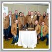 Contestants try on commemorative jackets during a reception. Kneeling, l. to r., Alexandre LaPalme-Lajeunesse, L-271; Joe Beauchamp, L-128; and Sean Walsh, L-203. Standing, l. to r., Ross Thompson, L-359; Brian Loos, L-359; Justin Brkic, L-73; Nathalie Delisle, L-271; Cory Malakoff, L-555; Roger McGuire, L-555; Paul Salisbury, L-128; James Mason, L-203; Dixon Lewis, L-73; Clayton Chiurka, L-146; and Neil Bennett, L-146.