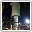 Boilermakers working for Madison Industrial lift the new reactor into place.
