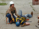 """Apprentice Brenda Healey, Local 83 (Kansas City), responds to fellow apprentice Matthew """"Scooter"""" Payne, Local 592 (Tulsa, Okla.), who plays the role of an injured worker."""