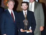 Jason Brown, Local 45, accepts the first-place trophy from Intl. Pres. Newton Jones, l., and Intl. V.P. Sean Murphy.