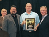 Local 500 (Salem, Ore.) BM-ST Darin McCarthy accepts the national NACBE safety award. Joining in the presentation are, l. to r., NACBE Exec. Dir. John Erickson, IVP J. Tom Baca, McCarthy, and IP Newton Jones.