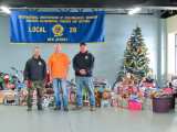 TAKING PART IN THE L-28 TOYS FOR TOTS DRIVE are l. to r., steward Robert Haslach, President Bob Flynn, and steward Wayne Van Wagner.