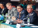 IBB International President Newton Jones, far right, Chairman of the IndustriALL Materials Industries Sector, speaks at the group's world conference. Joining him at the leadership table are, l. to r., Varanon Peetiwan, Thai Ministry of Labour; Matthias Hartwich, Materials Industries Director; and Kemal Özkan, IndustriALL Assistant General Secretary.